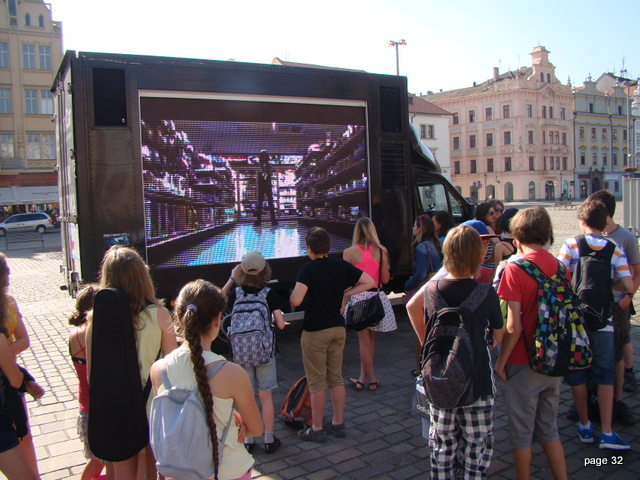 3.Children are watching SNTD clips on our multimedial TV car in Plzen city square
